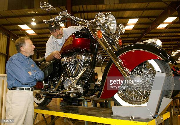 Indian Motorcycles CEO Frank O''Connell speaks with quality control inspector Gilbert Munoz about the new '2002 Chief Deluxe' model featuring the...