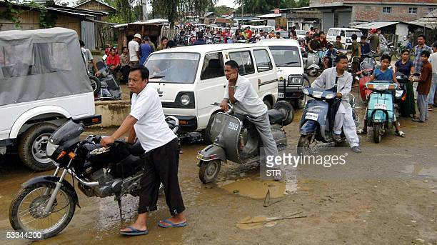 Indian motorists wait in a queue for fuel supplies outside a petrol station in Imphal 09 August 2005 as an economic blockade of the northeastern...