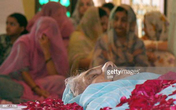 Indian mourners keep vigil alongside the body of Maharani Gayatri Devi at the City Palace in Jaipur on July 30, 2009. India mourned a jet-setting...