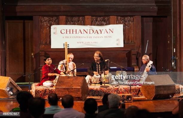 Indian musican Nayan Gosh plays the tabla as he leads his ensemble during a performance at the 14th Annual Chhandayan AllNight Concert of Indian...
