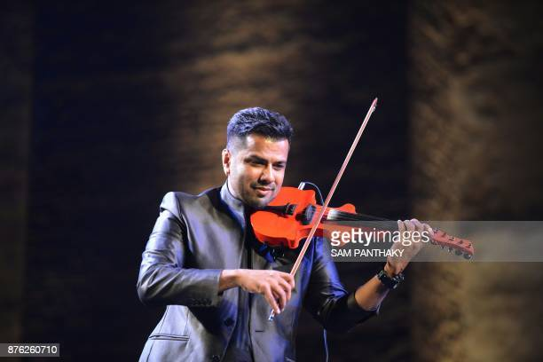 Indian musician Balabhaskar plays the violin during the Sufi Festival at the ancient Khan Masjid to mark the start of the World Heritage Week at...