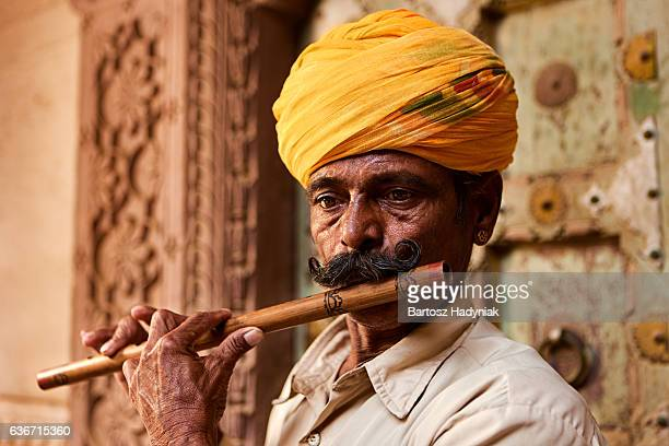 indian musician playing flute, jodhpur, rajasthan - indian music stock photos and pictures
