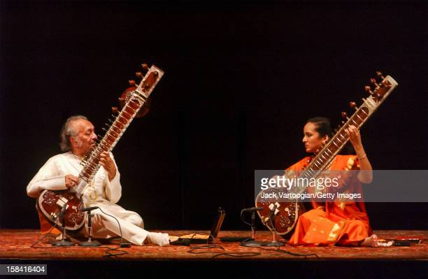 Indian musician Ravi Shankar and his daughter British musician Anoushka Shankar play a sitar duet during a performace at Carnegie Hall New York New...