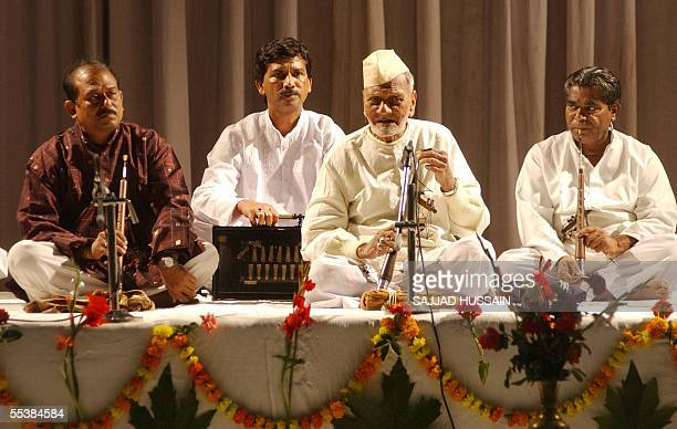 Indian musician Ustad Bismillah Khan performs in Srinagar 12 September 2005 to mark the opening of an industrial exhibition and cultural showthe...