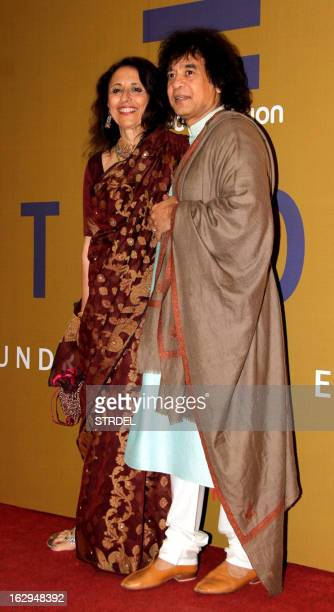 Indian musician Zakir Hussain and his wife Antonia Minnecola attend the NGO fund raiser Equation 2013 sponsored by Bollywood actor Rahul Bose in...