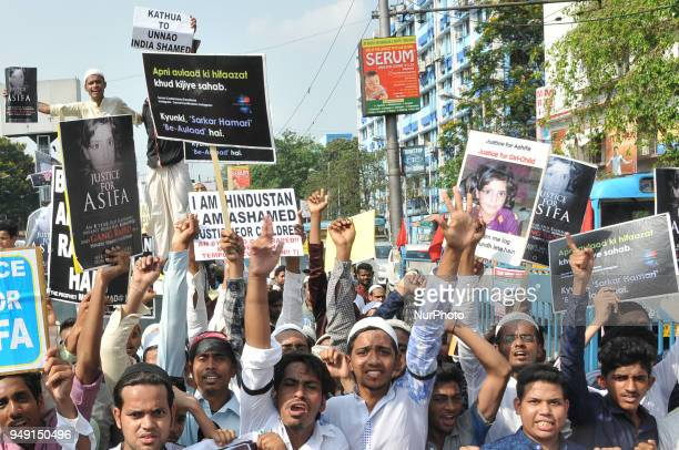 Indian Muslim activists hold placards during a protest calling for justice following the rape and murder of an eightyearold girl in the Indian state...