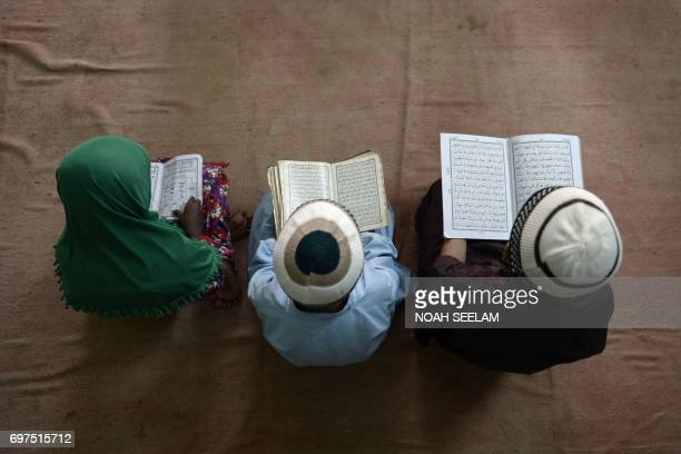 TOPSHOT Indian Muslim boys recite the Koran at the MadrasaturRashaad religious school in Hyderabad on June 19 during the holy month of Ramadan...