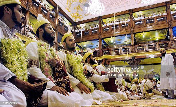 Indian Muslim bridegrooms of the Dawoodi Bohra sect wait their turn for blessings by his holiness Dr Syedna Mohammed Burhanuddin at the collective...