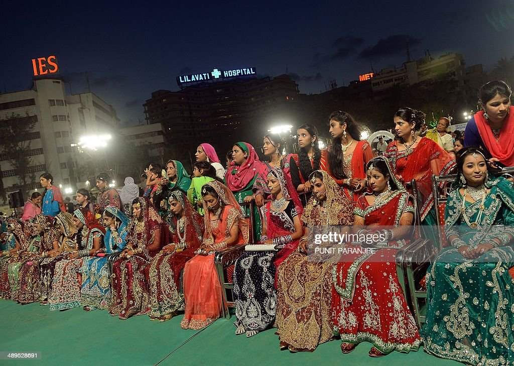 Indian Muslim brides take part in a mass marriage ceremony in Mumbai