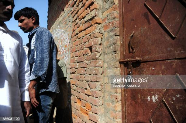 Indian Muslim butchers and traders gather outside a shuttered illegal slaughterhouse in the Naini neighborhood of Allahabad on March 21 2017 Locals...