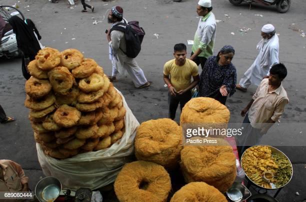 Indian Muslim buy khajla pheni on a shop for coming holy month of Ramadan at Jama masjid in new Delhi