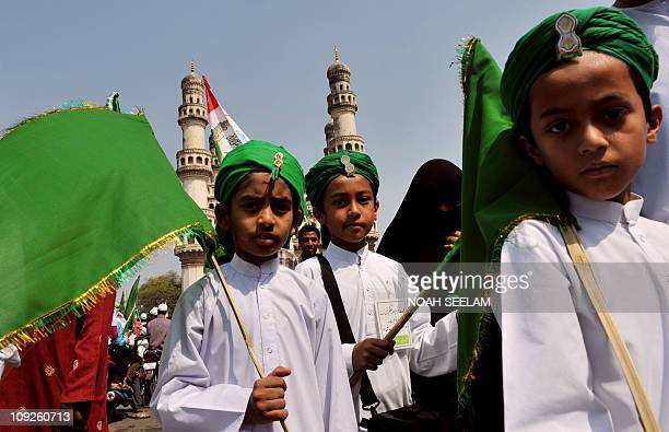 Indian Muslim children participate in an Eid Milad-un-Nabi festival procession in Hyderabad on February 16, 2011.Thousands of Muslims staged rallies...