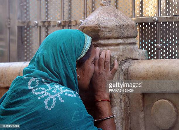 Indian Muslim devotee offers prayers at the Ajmer Sharif shrine in Ajmer on March 9 2013 Pakistan's Prime Minister Raja Pervez Ashraf is arriving in...