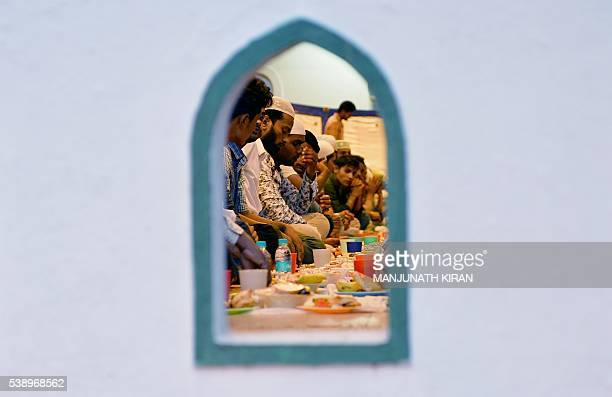 Indian Muslim devotees break their Ramadan fast with 'iftar' in Bangalore on June 9 2016 Across the Muslim world the faithful fast from dawn to dusk...
