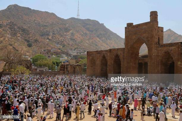 Indian Muslim devotees gather for Friday prayers at the AdhaiDin Ka Jhonpra mosque in Ajmer in the Indian state of Rajasthan on March 23 2018 The...