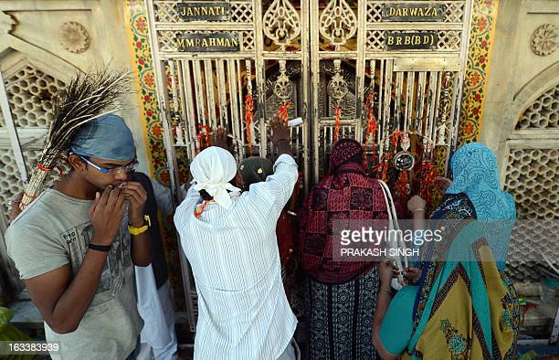 Indian Muslim devotees offer prayers at the Ajmer Sharif shrine in Ajmer on March 9 2013 Pakistan's Prime Minister Raja Pervez Ashraf is arriving in...