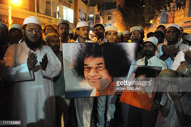 Indian muslim devotees offer prayers for the speed recovery of Satya Sai Baba outside the Prashanthi Nilayam at Puttaparthi some 472kms southwest of...