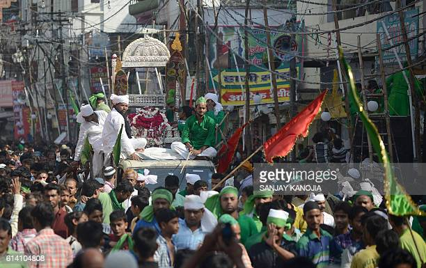 Indian Muslim devotees take out a 'Tajiya' or tableau during the mourning procession on the tenth day of Muharram which marks the day of Ashura in...