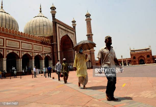 Indian Muslim devotees walk after offer Zohar namazâ while maintaining social distancing norms at Jama Masjid after all religious places reopened...