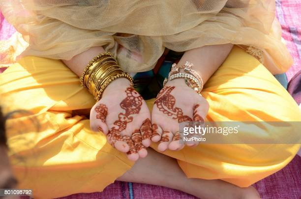 Indian Muslim girl child offering the Eid al Fitr prayers at Red Road in Kolkata, India on Monday, 26th June , 2017. Muslims around the world are...