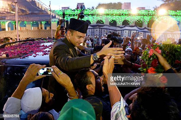 Indian Muslim leader of All India MajliseIttihad alMuslimin and member of the Legislative Assembly of the state of Telangana Akbaruddin Owaisi shakes...