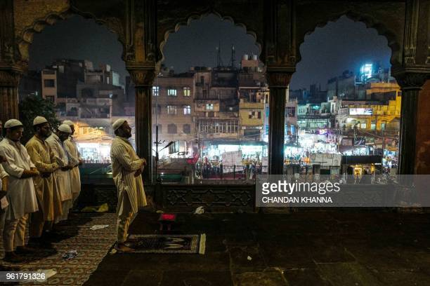 TOPSHOT Indian Muslim men perform the tarawih special prayer during the Islamic holy month of Ramadan inside the Jama Masjid in the old quarters of...