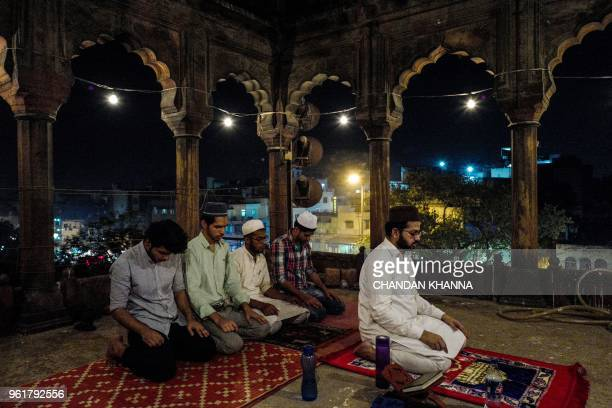 TOPSHOT Indian Muslim men perform the tarawih special prayer during the Islamic holy month of Ramadan at the Jama Masjid in the old quarters of New...