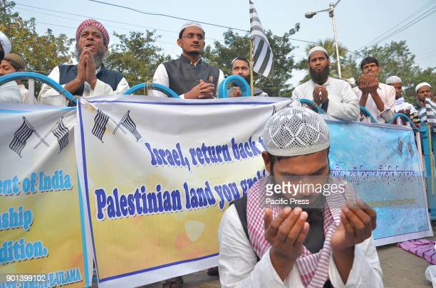 Indian Muslim men prayer for the Al Aqsa mosque in the Old City of JerusalemWest Bengal State Jamait Ulama EHind activists and supporters during a...