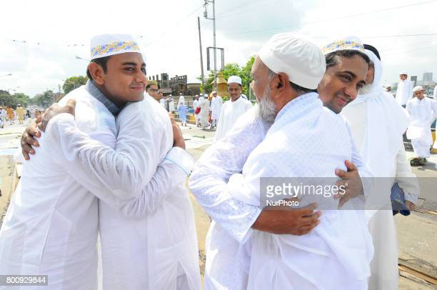Indian Muslim personnel exchange Eid greetings to one another after offering Eid alFitr prayers on June 262017 in Kolkata India