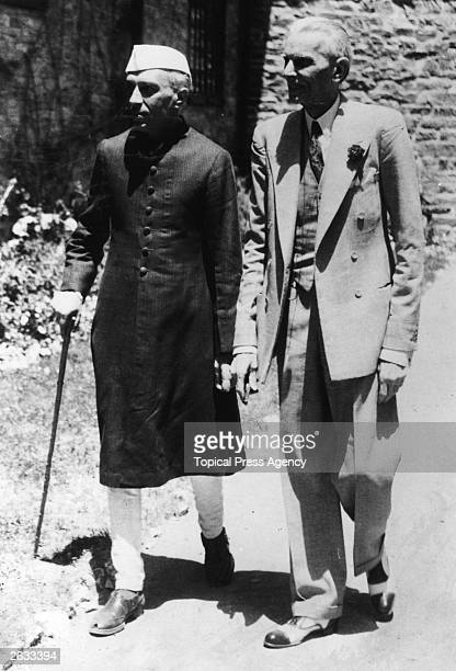 Indian Muslim politician Muhammad Ali Jinnah right leaves his residence with Indian Prime Minister Jawaharlal Pandit Nehru after a 90minute...