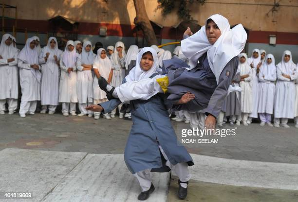 Indian Muslim schoolgirls perform 'Vovinam' the Vietnamese martial art at Saint Maaz High School in Hyderabad on January 24 to mark National Girl...