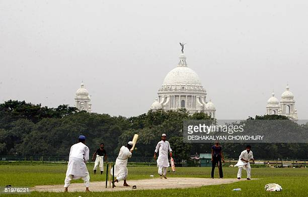 Indian Muslim students of a local madrassa play cricket on The Maidan a large expanse of grass in Kolkata on July 18 2008 The Maidan is the largest...