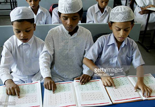 Indian Muslim students recite Qaeda during a special class on Islamic teachings in a Muslim Minority High School in Hyderabad on September 5 2008...