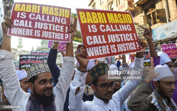 Indian Muslim supporters and activists take part in a protest to mark the 26th anniversary of the demolition of the 16th century Babri Masjid located...