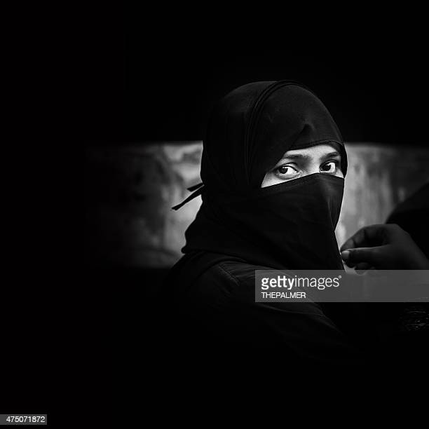 indian muslim woman - muslim woman darkness stock photos and pictures