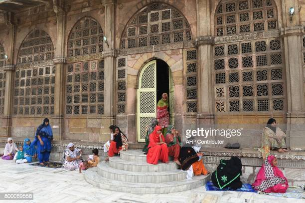 Indian Muslim women assemble prior to offering prayers on the last congregational Friday prayers of the holy month of Ramadan ahead of the Muslim...