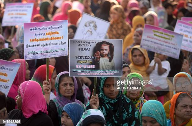 Indian Muslim women hold placards and shout slogans during a protest against the recent rape and murder case of an eightyearold girl in the Indian...