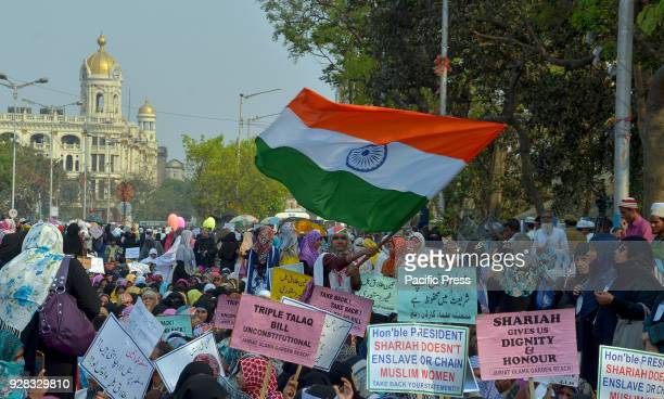 Indian Muslim women hold placards and take part in a silent protest rally to demand a repeal of of the 'triple talaq' or instant divorce bill