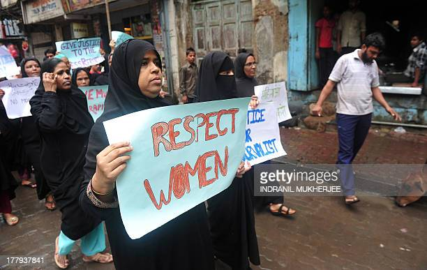 Indian Muslim women hold posters during a protest march against the gangrape of a female photographer in Mumbai on August 26 2013 Mumbai police...