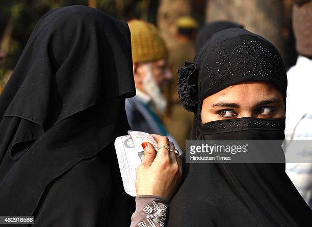 Indian Muslim women in queue to cast their votes during the Delhi Assembly Elections 2015 on February 7 2015 in New Delhi India Delhi is headed for a...