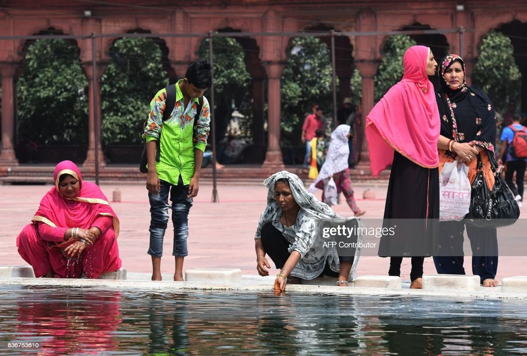 Indian Muslim women perform ablution at the Jama Masjid mosque in New Delhi on August 22, 2017. India's top court on August 22 banned a controversial Islamic practice that allows men to divorce their wives instantly, ending a long tradition that many Muslim women had fiercely opposed. PHOTO / Prakash SINGH