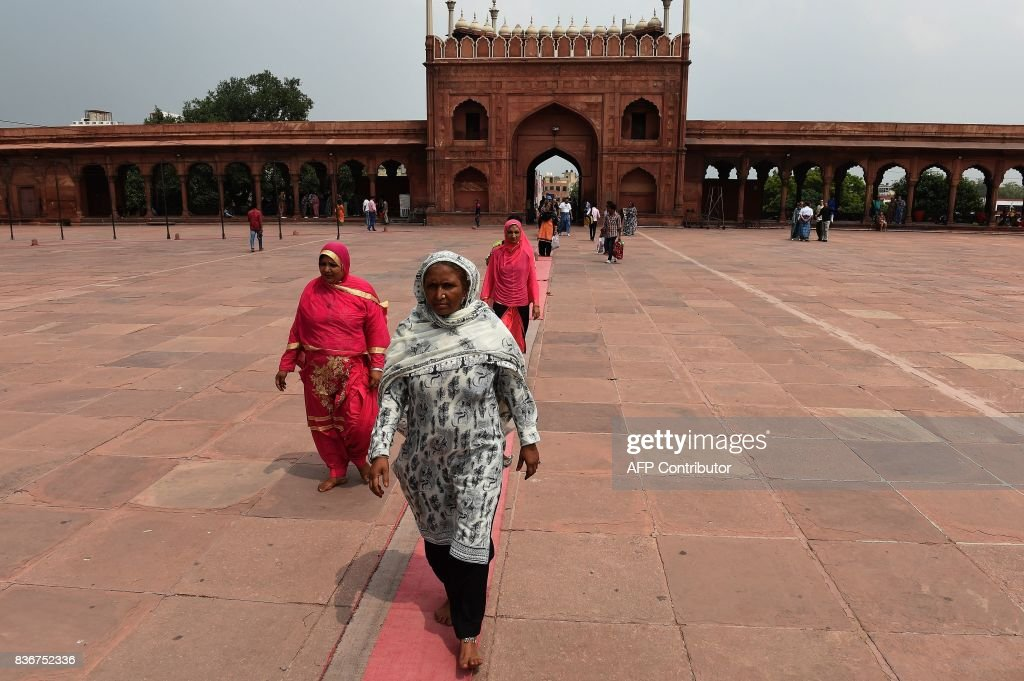 Indian Muslim women visit the Jama Masjid mosque in New Delhi on August 22, 2017. India's top court on August 22 banned a controversial Islamic practice that allows men to divorce their wives instantly, ending a long tradition that many Muslim women had fiercely opposed. PHOTO / Prakash SINGH