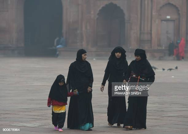 Indian Muslim women visit the Jama Masjid mosque in New Delhi on January 3 2018 The Indian parliament's upper house will consider a bill January 3...