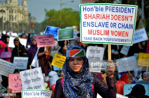Indian Muslim women's hold placards and take part in a silent protest rally to demand a repeal of the 'triple talaq' or instant divorce bill