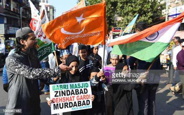 Indian Muslims and activists take part in a protest to mark the 26th anniversary of the demolition of the 16th century Babri Masjid located in...