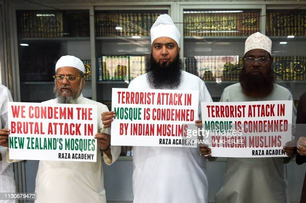 Indian Muslims and clerics hold posters to condemn the mass shooting that occured at multiple mosques in New Zealand city of Christchurch during an...