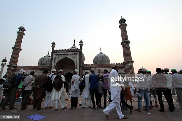 Indian Muslims before iftar meal on the first day of the holy month of Ramadan at Jama Masjid mosque in the old quarters of Delhi on June 192015