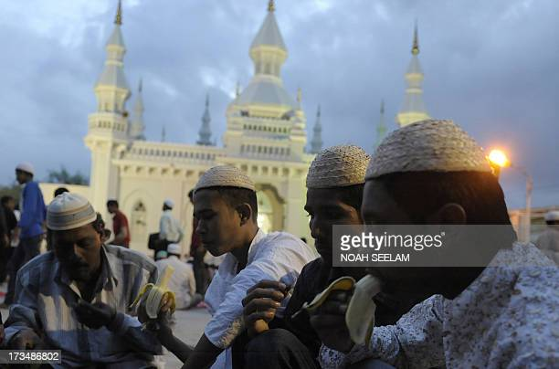 Indian Muslims break their fast during the month of Ramadan at JamaeMasjid Aiwan mosque in Hyderabad on July 15 2013 Islam's holy month of Ramadan is...