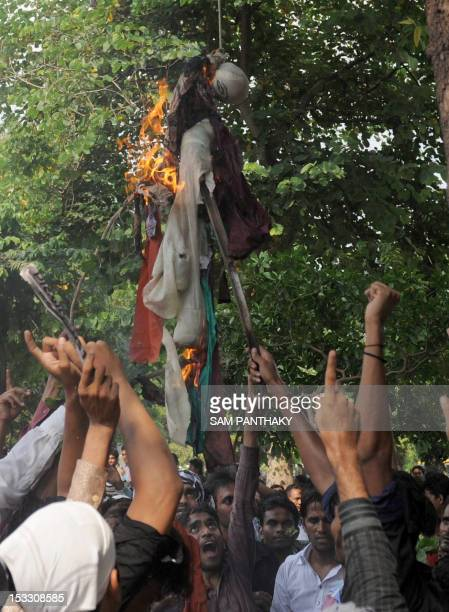 Indian Muslims burn an effigy of Nakoula Basseley the alleged producer of antiIslam video during a protest against the film in Ahmedabad on October 3...
