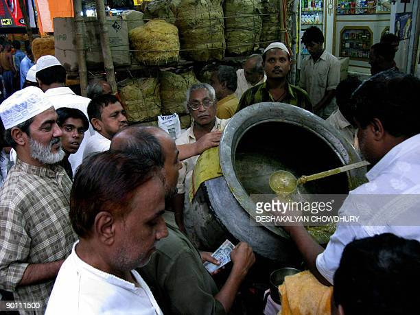 Indian Muslims buy Haleem to break their fast during the holy month of Ramadan at a market place in Kolkata on August 27 2009 During Ramadan Muslims...